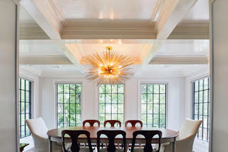 A coffered ceiling and taller windows added to the new dining room provide architectural interest.