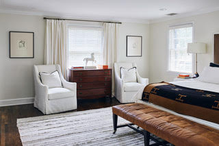 Linen, cotton, leather and wool create visual texture in this simple yet complex master bedroom.